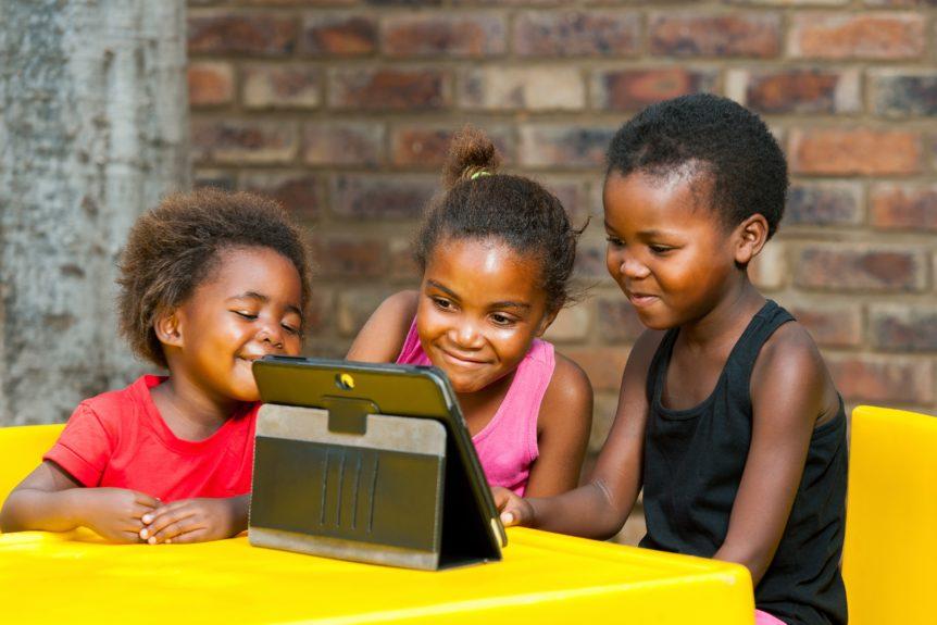 Children learning on tablet